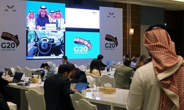 FILE PHOTO: Journalists sit in the media center during the meeting of G20 finance ministers and central bank governors in Riyadh, Saudi Arabia, February 22, 2020./File Photo