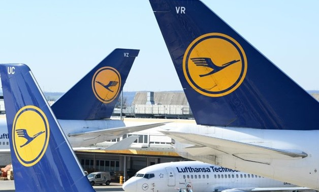 FILE PHOTO: Airplanes of German carrier Lufthansa are parked on the tarmac as air traffic is affected by the spread of the coronavirus disease (COVID-19), in Frankfurt, Germany