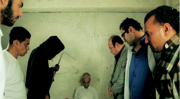 A scene from Al-Nowairy's short film I Am Diaa, which shows the protagonist inside his cell surrounded by the shadows of people he knew.