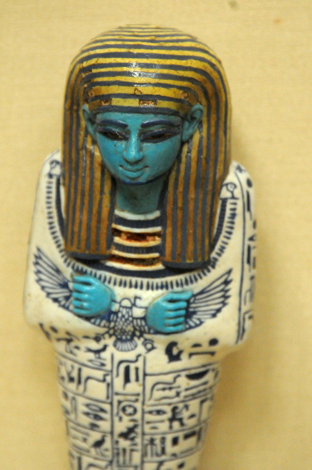 A blue painted sculpture of Nofret, a noblewoman and princess who lived during the 4th dynasty.