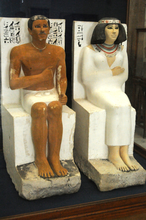 "Rahotep, high priest of Heliopolis, and his wife Nofret, whose name means ""The Beautiful."" A vivid feeling is conveyed by te two figures, which feature remarkable preservation of the painted surface."