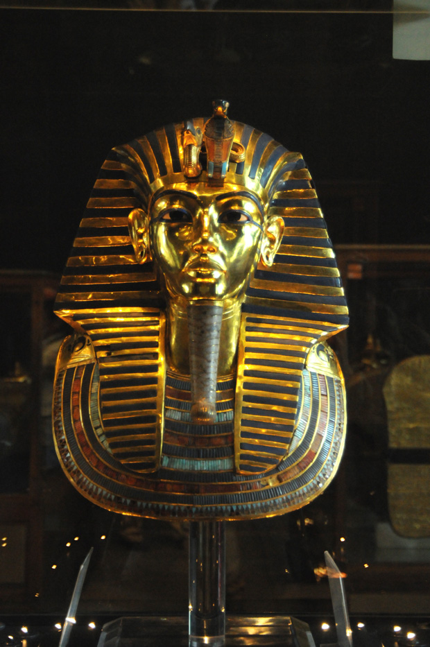 The famous golden mask that was found over the royal mummy's head when King Tutankhamun's tomb was discovered. The piece is one of the museum's most iconic.