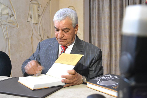 Hawass signing copies of Scanning the Pharaohs at the book launch in Cairo.