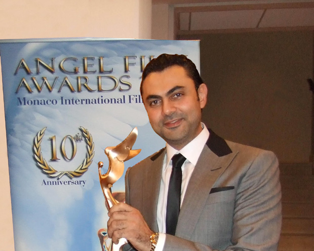 Karim accepeting the Best Actor award for Facebook Romance.
