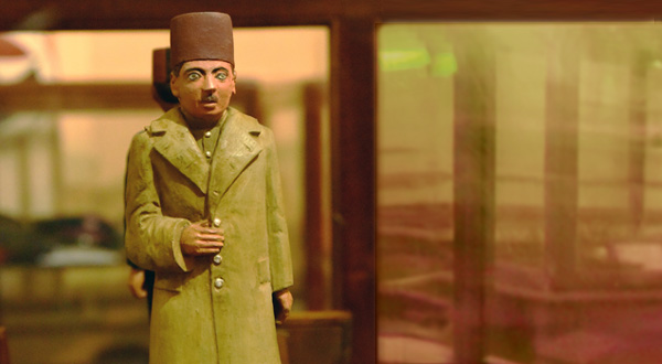 A figurine on display shows the overcoat and uniform worn by postmen of the past.