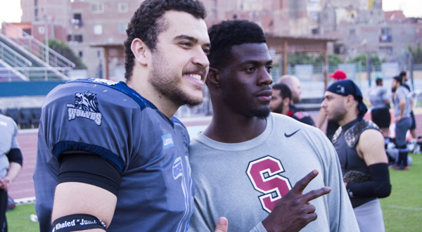 Johnson Bademosi (right) a cornerback for the Detroit Lions, poses with an Egyptian player.