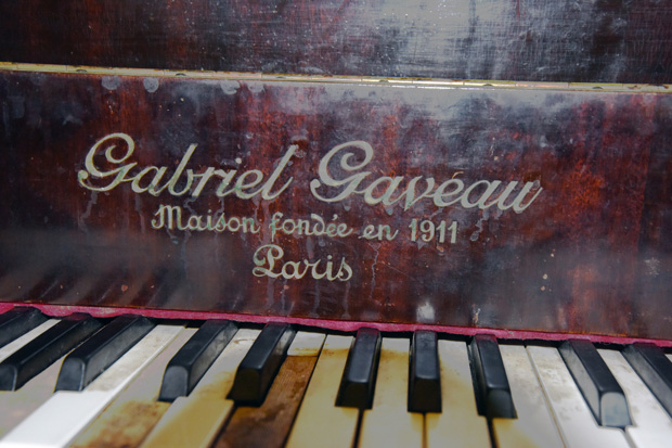 The antique piano inside the Trianon Cafe.