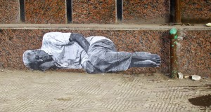 """Homeless Man,"" graffiti drawn on the wall of the library at the governorate building, Mansoura."