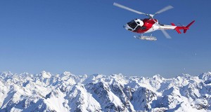 travel-france-italy-mountains-helicopter-featured