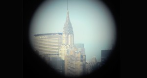 The Chrysler Building, an Art Deco skyscraper in Midtown Manhattan, as seen from a coinoperated telescope at a public park in Williamsburg.