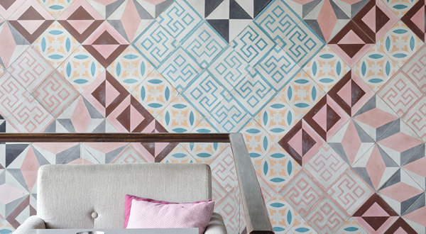 Eklego created this massive floor-to-ceiling feature tile wall with an explosion of pattern and color that really brings Pottery Cafe's interior to life.